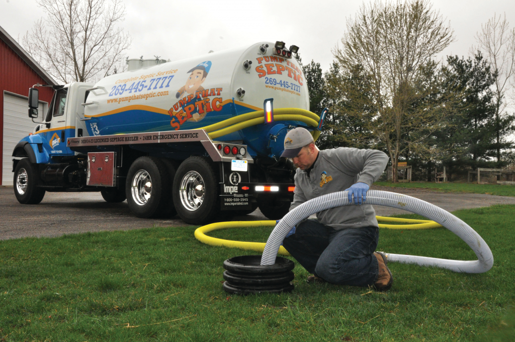 Pump that Septic, pumps out a septic tank using an International 7400 with a 3,200 gallon tank purchased from Imperial Industries