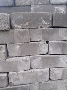 Fly Ash Bricks, Fly ash is a fine powder that is a byproduct of burning pulverized coal in electric generation power plants. Fly ash is a pozzolan, a substance containing aluminous and siliceous material that forms cement in the presence of water. When mixed with lime and water, fly ash forms a compound similar to Portland cement. This makes fly ash suitable as a prime material in blended cement, mosaic tiles, and hollow blocks, among other building materials.