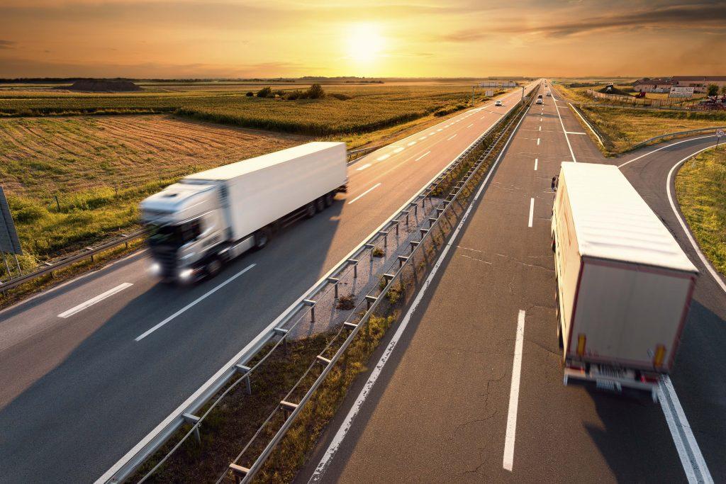 Trucks zooming on highway
