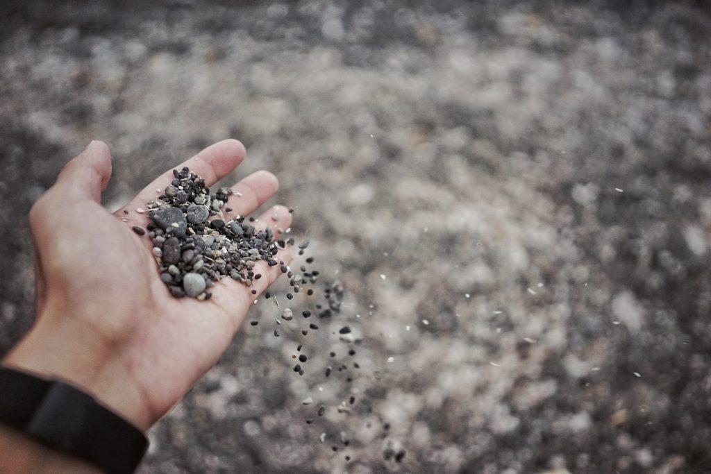Gravel in hands, gravel, aggregate, grey gravel