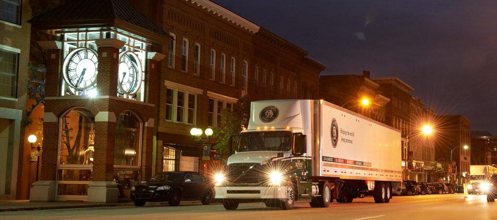 Old Dominion Freight Line Truck at night next to old brick building