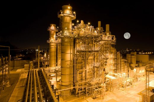 Natural gas plant at night with moon