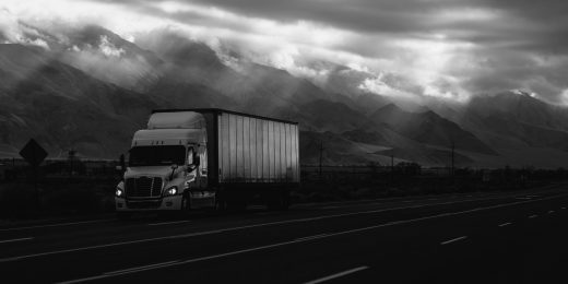 Truck on Highway next to mountain - B&W