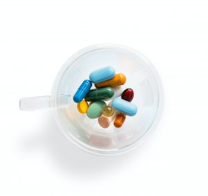 Pills in a cup ...Photo by Adam Nieścioruk on Unsplash