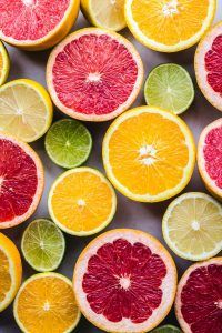 Photo by Bruna Branco on Unsplash, citrus fruits, berries and watermelons