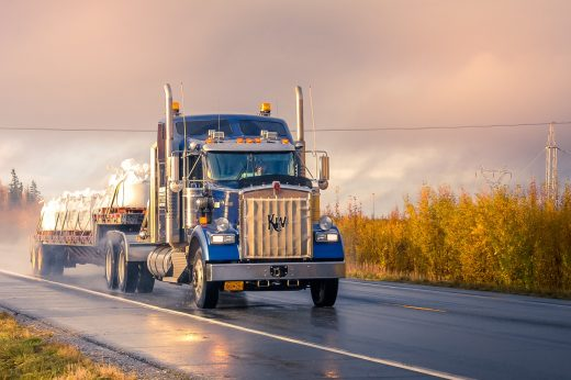 Truck driving on the road in Alaska